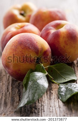 fresh peaches on wood background - stock photo