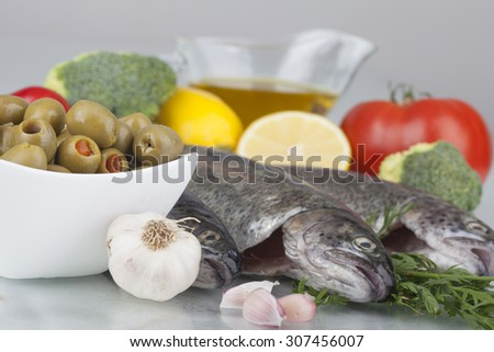 fresh trout on a cutting board - stock photo