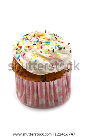 freshly baked vanilla cupcakes with lemon buttercream and sprinkles - stock photo