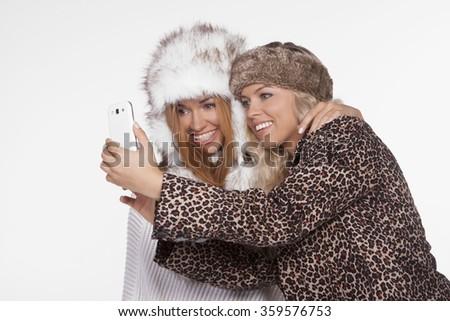 Friends having fun taking selfie. studio shoot - stock photo