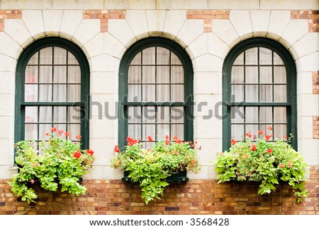 3 Frontenac's castle windows with flower boxes - stock photo