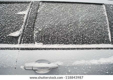 Frozen side window of  car closeup - stock photo