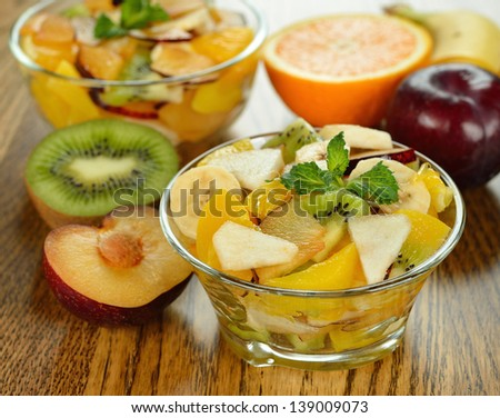 Fruit salad on a brown table - stock photo