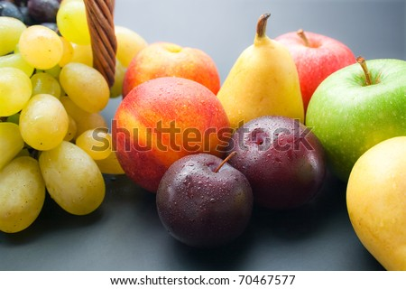 Fruits. Various fresh ripe fruits close-up: plums, peaches, pears, apples and grapes. - stock photo