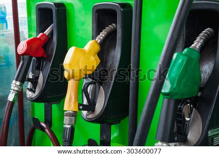 fuel nozzle a gasoline station - stock photo