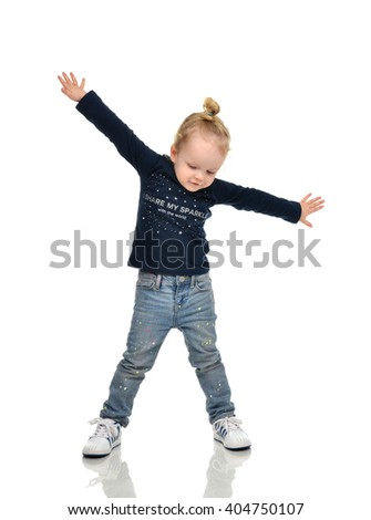 Full body of happy young little child girl gesturing keeping arms raised and expressing positivity isolated on white background - stock photo