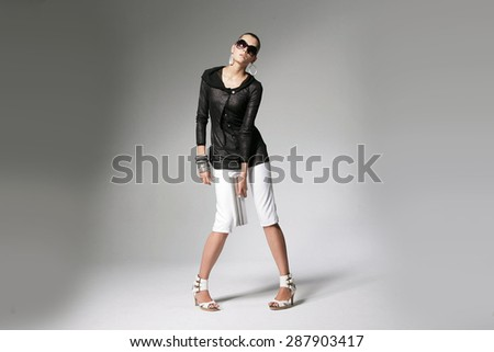 Full body portrait of young beautiful girl in sunglasses , Fashion photo - stock photo