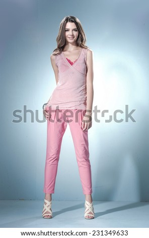 full-length portrait of a styled professional model �light background - stock photo