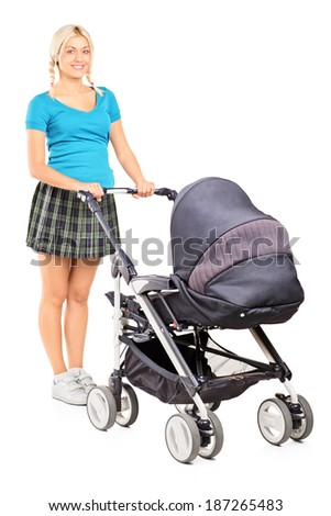 Full length portrait of a young woman pushing a baby stroller isolated on white background - stock photo