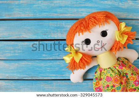fun rag doll on wooden  background - stock photo