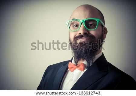 funny elegant bearded man on vignetting background - stock photo
