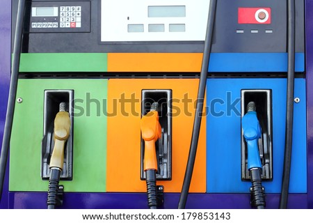 gas pump nozzles on service station  - stock photo
