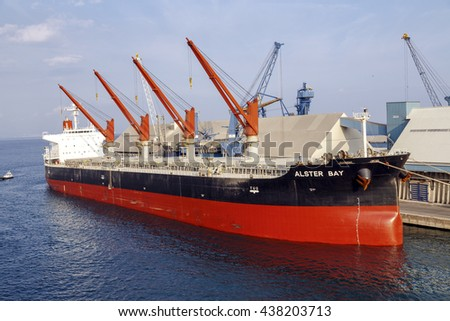 Genoa, Italy - September 27, 2015: The ship ALSTER BAY in Genoa port is a Buque granelero registered in Panama. Has a deadweight of 55430 tonnes and was built in 2008. The gross tonnage is 30816. - stock photo
