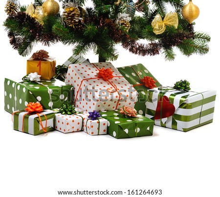 gift boxes  under decorated Christmas tree on white background - stock photo