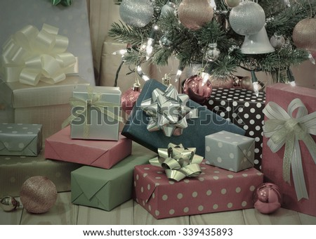 Gift boxes with Christmas tree  on wooden background, pastel colour  - stock photo