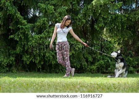 girl and her faithful siberian husky - stock photo