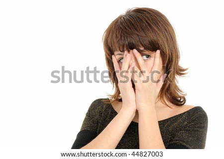 girl  is gazing through her fingers - stock photo