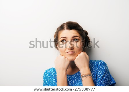 girl props up fists chin - stock photo