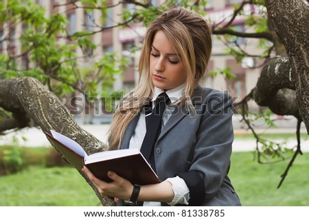 Girl reads a book - stock photo