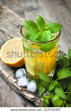 glass of lemonade, mint and lemon - stock photo