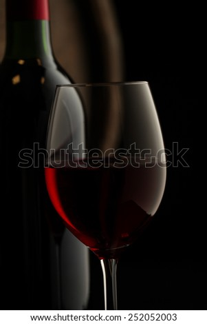 glass of red wine on a table in a vintage beer cellar - stock photo