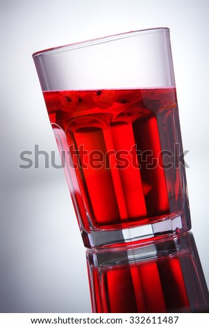 glass with red water - stock photo