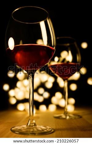 2 glasses of red wine. Christmas, romantic, valentine dinner image.  - stock photo