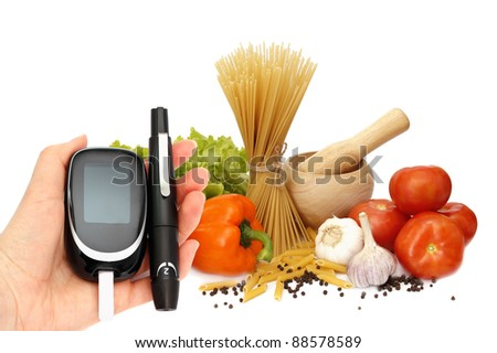 glucosemeter and healthy food - stock photo
