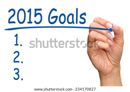 2015 Goals - female hand writing text on white background - stock photo