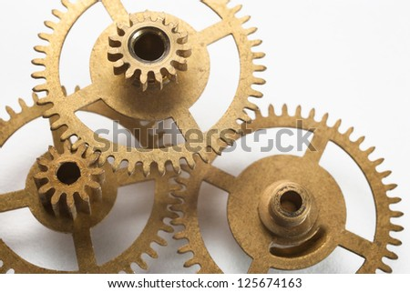 gold clock gear on white background - stock photo