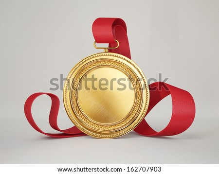 gold medal isolated on a grey background - stock photo