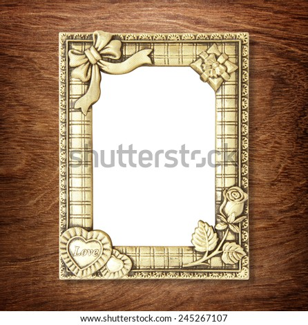 gold picture frame on wooden wall ;. Empty picture frame on wooden wall. - stock photo