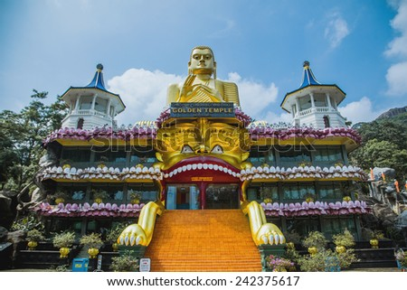 Golden temple  in Dambulla, Sri Lanka.  The largest and best-preserved cave temple complex in Sri Lanka. Monument declared a World Heritage Site by Unesco. - stock photo