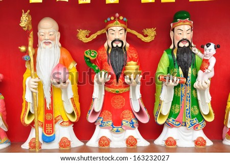 Good Fortune (Fu,Hok), Prosperity (Lu,Lok), and Longevity (Shou,Siu) statue. - stock photo