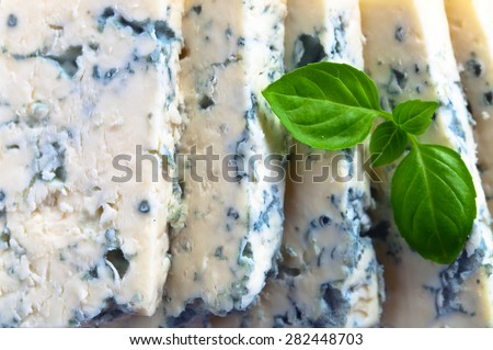 gorgonzola cheese with basil , focus on a center - stock photo