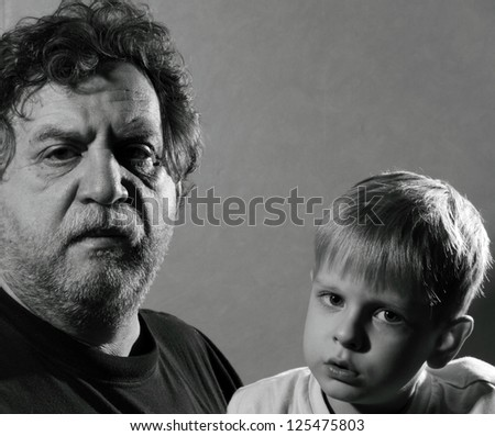 Grandfather and grandson, black and white - stock photo