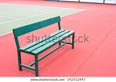 green chair in the tennis court. - stock photo