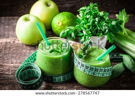 green Detox smoothie on wooden table - stock photo