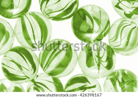 Green glass marbles on white background - stock photo