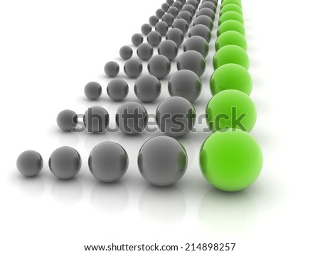 green sphere placed observably in a group of gray spheres. - stock photo