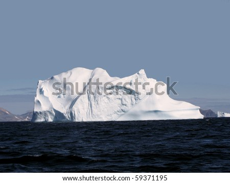 Greenland iceberg in a bay - stock photo