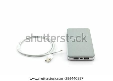 Grey power bank on white background. - stock photo