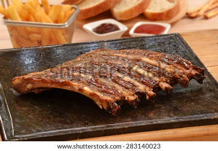 Grilled pork rib meat on top of grill stone. - stock photo