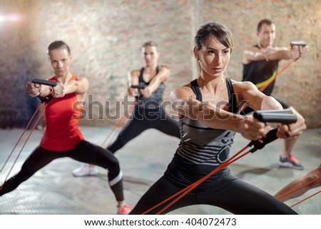group exercising with a resistance band  - stock photo