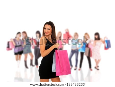 Group of beautiful young shopping women with girls holding bags  - stock photo