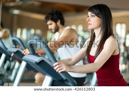 Group of people running on treadmills  - stock photo