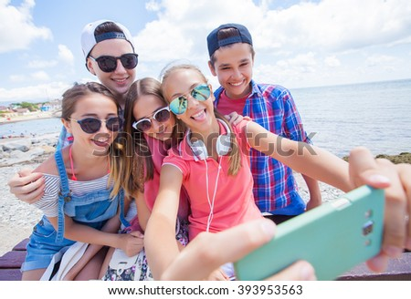 group of teenagers making fun selfie together - stock photo