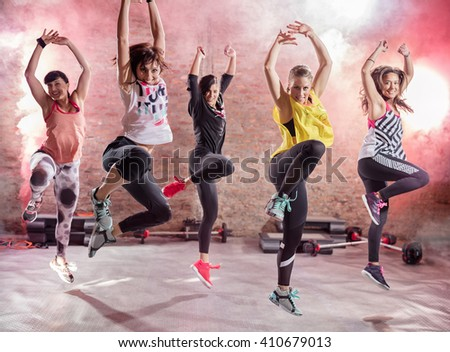 Group of young women  dancing, fun and exercising - stock photo
