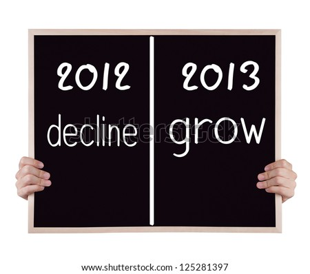 2013 grow compare with 2012 decline on blackboard with hands - stock photo