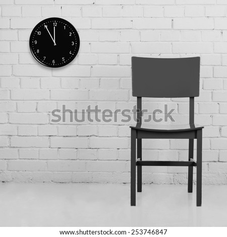��¡hair against brick wall with clock. Converted in B&W - stock photo